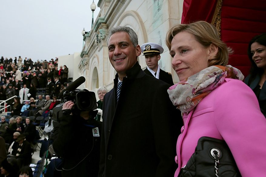 Chicago Mayor Rahm Emanuel and wife Amy Rule arrive before the presidential inauguration on the West Front of the U.S. Capitol January 21, 2013 in Washington, DC.   Barack Obama was re-elected for a second term as President of the United States.  (Photo by POOL Win McNamee/Getty Images)