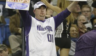 Sacramento Kings fan Darren Fitch calls on the Maloof family, owners of the Kings to sell the team to local buyers during a timeout in the Kings game agains the Dallas Mavericks in Sacramento, Calif., Thursday, Jan. 10, 2012. Word of the possible sale of the team to a group that would move the franchise to Seattle has Kings fan showing their support with hopes they will remain in Sacramento. The Mavericks won in overtime 117-112.(AP Photo/Rich Pedroncelli)