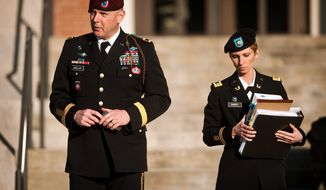 Army Brig. Gen. Jeffrey A. Sinclair (left) leaves a Fort Bragg courthouse with a member of his defense team, Maj. Elizabeth Ramsey, on Jan. 22, 2012, after he deferred entering a plea at his arraignment on charges of fraud, forcible sodomy, coercion and inappropriate relationships. Sinclair, who served five combat tours, is headed to trial following a spate of highly publicized military sex scandals involving high-ranking officers that has triggered a review of ethics training across the service branches. (Associated Press/The Fayetteville Observer)