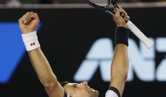 Serbia's Novak Djokovic celebrates his win over Tomas Berdych of the Czech Republic in their quarterfinal match at the Australian Open tennis championship in Melbourne, Australia, Tuesday, Jan. 22, 2013. (AP Photo/Dita Alangkara)