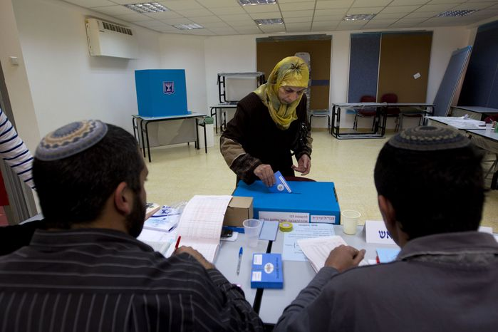 An Arab Israeli woman casts her vote during legislative elections in the central Israeli town of Tira on Tuesday, Jan. 22, 2013. (AP Photo/Ariel Schalit)