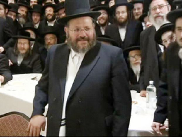 Nechemya Weberman attends a fundraiser on March 16, 2012, in the Brooklyn borough of New York, where his supporters contributed to a legal defense fund for his trial on charges of sexually abusing a girl he was supposed to be counseling. (AP Photo/WCBS-TV)