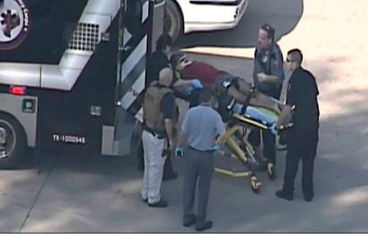 In this frame grab provided by KPRC Houston, an unidentified person is transported by emergency personnel at Lone Star College on Jan. 22, 2013, in Houston, where law enforcement officials say the community college is on lockdown amid reports of a shooter on campus. (Associated Press/Courtesy KPRC TV)