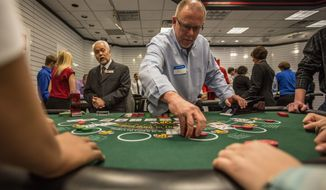 Mel Lorton practices how to properly run a game during training for those seeking jobs as casino dealers at Maryland Live Casino. The training school is in a store at the Marley Station Mall in Glen Burnie, Md. The school is just one step in the selection process. (Andrew S. Geraci/The Washington Times)