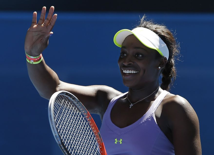Sloane Stephens of the United States reacts after defeating compatriot Serena Williams in their quarterfinal match at the Australian Open tennis championship in Melbourne, Australia, on Wednesday, Jan. 23, 2013. (AP Photo/Andy Wong)