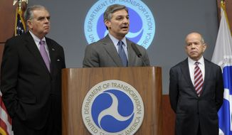 ** FILE ** Boeing Commercial Airplanes President Ray Conner (center), flanked by Transportation Secretary Ray LaHood (left) and Federal Aviation Administration chief Michael Huerta, speaks during a news conference at the Transportation Department in Washington on Friday, Jan. 11, 2013, to discuss a comprehensive review of the Boeing 787's critical systems, including its design, manufacture and assembly. (AP Photo/Susan Walsh)