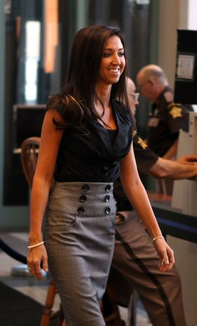 ** FILE ** Sarah Jones, a former high school teacher and Cincinnati Bengals cheerleader, arrives at the Kenton County Justice Center in Covington, Ky., on Monday, July 30, 2012. (AP Photo/The Enquirer, Patrick Reddy)
