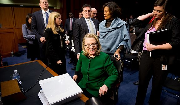 Secretary of State Hillary Rodham Clinton leaves after testifying on Capitol Hill on Wednesday, Jan. 23, 2013, before the Senate Foreign Relations Committee on the Sept. 11, 2012, attacks against the U.S. Consulate in Benghazi, Libya. (Andrew Harnik/The Washington Times)