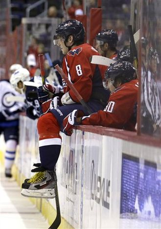 Washington Capitals left wing Alex Ovechkin (8) from Russia, rests on the bench boards during a timeout in the third period of an NHL hockey game against the Winnipeg Jets Tuesday, Jan. 22, 2013 in Washington. The Jets won 4-2. (AP Photo/Alex Brandon)