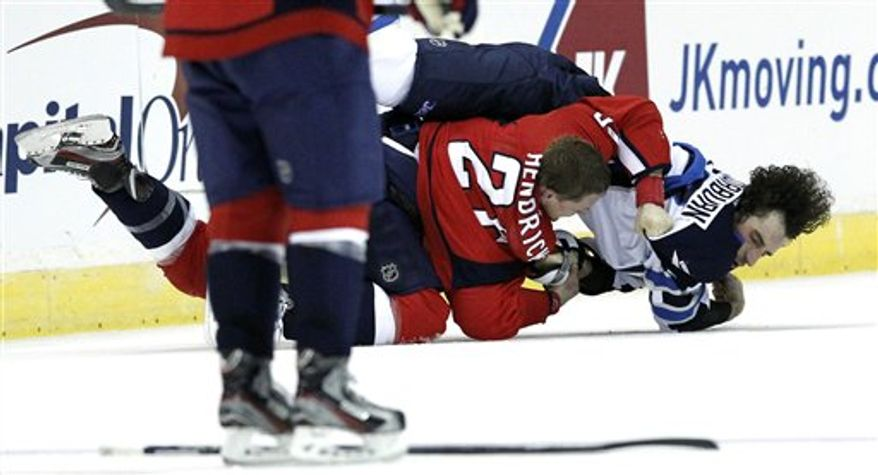Washington Capitals center Matt Hendricks (26) brings Winnipeg Jets right wing Chris Thorburn (22) to the ice during a fight in the third period of an NHL hockey game Tuesday, Jan. 22, 2013 in Washington. The Jets won 4-2. (AP Photo/Alex Brandon)