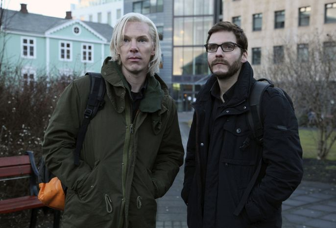 """Benedict Cumberbatch (left) stars as WikiLeaks founder Julian Assange with Daniel Bruhl as Daniel Domscheit-Berg in """"The Fifth Estate."""" The film, which traces the controversial WikiLeaks website from its early days to the release of a series of controversial and history changing information leaks, is due out in the U.S. in November. (Associated Press/DreamWorks Studios)"""