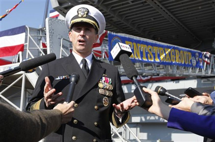 ** FILE ** Adm. Jonathan Greenert, chief of naval operations, gestures as he address the media in front of the USS Enterprise at Naval Station Norfolk on Saturday, Dec. 1, 2012, in Norfolk, Va., before an inactivation ceremony for the Enterprise, the first nuclear-powered aircraft carrier. The ship served in the fleet for 51 years. (AP Photo/Steve Helber)