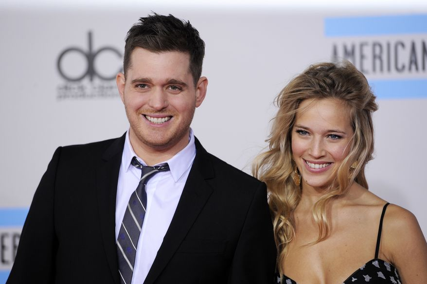 Singer Michael Buble and actress-model Luisana Lopilato attend the 38th annual American Music Awards in Los Angeles in 2010. The duo, who were married in 2011, are expecting their first baby. (AP Photo/Chris Pizzello)