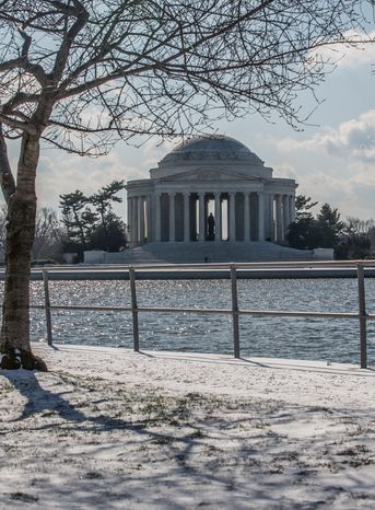 The Jefferson Memorial attracts a few brave souls who venture out during the first snow fall of the year, in Washington, D.C., Thursday, Jan. 24, 2013. (Andrew S. Geraci/The Washington Times)