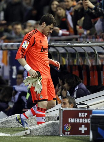 Real Madrid's goalkeeper Iker Casillas leaves the field injured during their a Copa del Rey soccer match against Valencia at the Mestalla stadium in Valencia, Spain, Wednesday, Jan. 23, 2013. (AP Photo/Alberto Saiz)