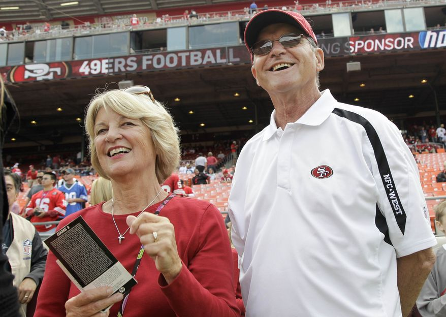 ** FILE ** In this Sept. 11, 2011 file photo, Jackie and Jack Harbaugh, parents of San Francisco 49ers coach Jim Harbaugh and Baltimore Ravens coach John Harbaugh, stand before an NFL football game between the 49ers and the Seattle Seahawks in San Francisco. The entire Harbaugh family already got its Super Bowl victory last Sunday, when each coach did his part to ensure a family reunion in New Orleans next week. The Ravens face off against the 49ers in the first Super Bowl coached by siblings on opposite sidelines. (AP Photo/Paul Sakuma)