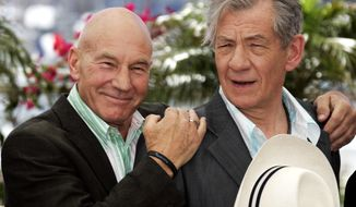 "Sir Patrick Stewart (left) hugs Sir Ian McKellen during a photo call for the film ""X-Men: The Last Stand"" at the 59th Cannes Film Festival in France in 2006. (AP Photo/Jeff Christensen)"