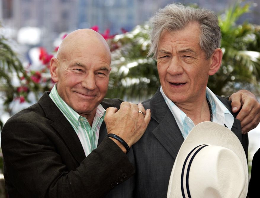 """Sir Patrick Stewart (left) hugs Sir Ian McKellen during a photo call for the film """"X-Men: The Last Stand"""" at the 59th Cannes Film Festival in France in 2006. (AP Photo/Jeff Christensen)"""