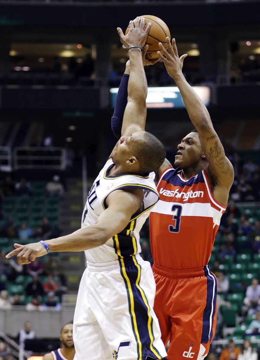Utah Jazz's Randy Foye, left, blocks the shot of Washington Wizards' Bradley Beal (3) during the first quarter of an NBA basketball game, Wednesday, Jan. 23, 2013, in Salt Lake City. (AP Photo/Rick Bowmer)