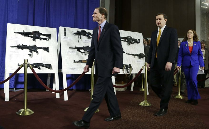 From left; Sen. Richard Blumenthal, D-Conn., Sen. Chris Murphy, D-Conn., and Rep. Elizabeth Esty, D-Conn. arrive for a news conference on Capitol Hill, in Washington to introduce legislation on assault weapons and high-capacity ammunition feeding devices, Thursday, Jan. 24, 2013. (AP Photo/Manuel Balce Ceneta)