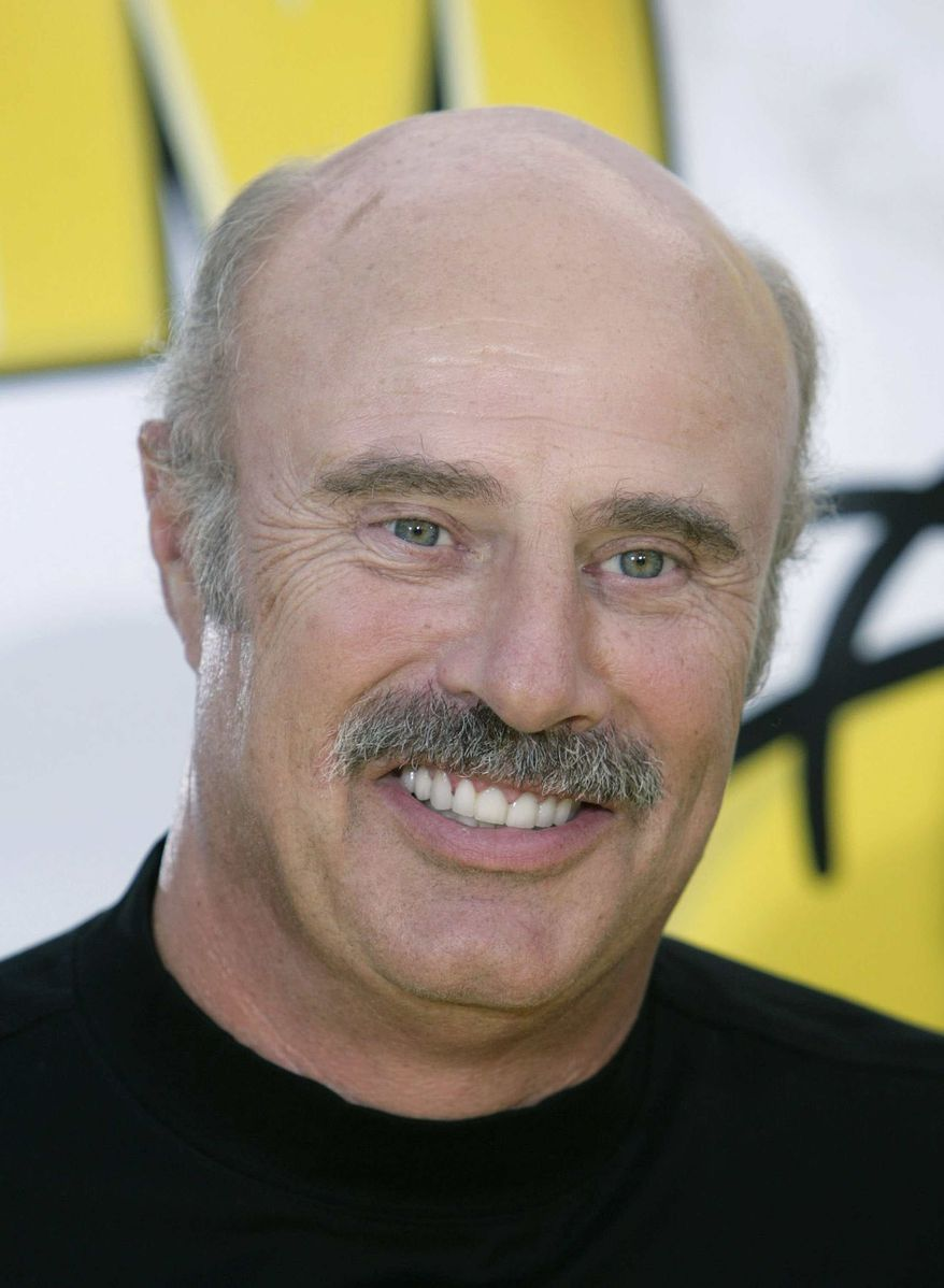 """** FILE ** In this July 24, 2007, file photo, Dr. Phil McGraw is shown in Los Angeles. McGraw has booked the first on-camera interview with the man who allegedly concocted the girlfriend hoax that ensnared Notre Dame football star Manti Te'o, confirmed on Friday, Jan. 25, 2013, by a spokesperson for the """"Dr. Phil Show."""" (AP Photo/Matt Sayles, File)"""