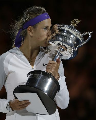 Victoria Azarenka of Belarus kisses her trophy after winning the women's final against China's Li Na at the Australian Open tennis championship in Melbourne, Australia, Saturday, Jan. 26, 2013. (AP Photo/Andy Wong)
