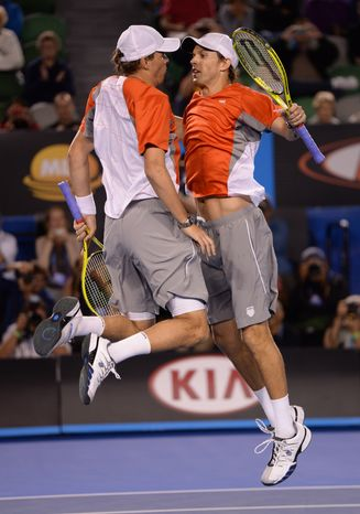 Bob and Mike Bryan of the US celebrate after defeating Robin Haase and Igor Sijsling of the Netherlands in the men's doubles final at the Australian Open tennis championship in Melbourne, Australia, Sunday, Jan. 27, 2013. (AP Photo/Andrew Brownbill)