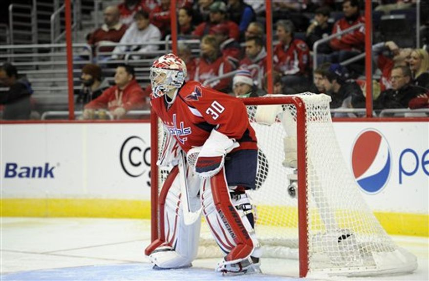 Washington Capitals goalie Michal Neuvirth (30), of the Czech Republic, looks on during the third period of an NHL hockey game against the Montreal Canadiens, Thursday, Jan. 24, 2013, in Washington. The Canadiens won 4-1.(AP Photo/Nick Wass)