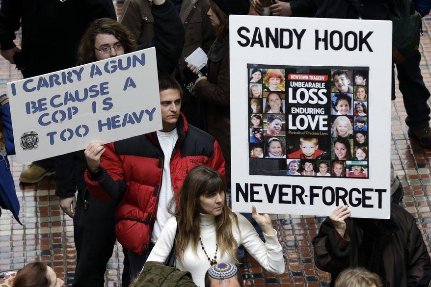 ** FILE ** Gun rights and gun control advocates demonstrate in the Pennsylvania Capital building Wednesday, Jan. 23, 2013, in Harrisburg, Pa. (AP Photo/Matt Rourke);