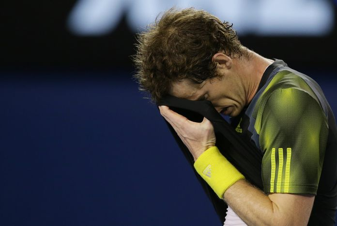 Britain's Andy Murray wipes the sweat from his face during the men's final against Serbia's Novak Djokovic at the Australian Open tennis championship in Melbourne, Australia, Sunday, Jan. 27, 2013. (AP Photo/Aaron Favila)