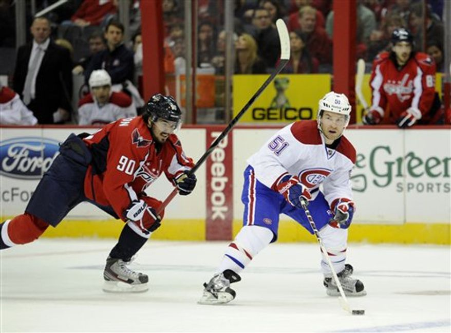 Washington Capitals center Marcus Johansson (90), of Sweden, chases Montreal Canadiens center David Desharnais (51) during the third period of an NHL hockey game, Thursday, Jan. 24, 2013, in Washington. The Canadiens won 4-1.(AP Photo/Nick Wass)