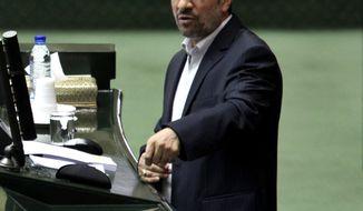 Iranian President Mahmoud Ahmadinejad speaks in the parliament in Tehran on Wednesday, Jan. 16, 2013. (AP Photo/Vahid Salemi)
