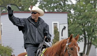Milwaukee County, Wis., Sheriff David A. Clarke Jr. rides his horse during the Mexican Independence Day Parade in Milwaukee in 2010. (AP Photo/Milwaukee Journal Sentinel, John Klein) ** FILE **