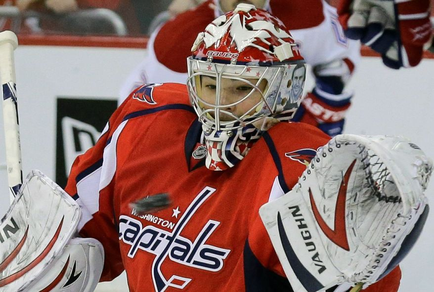 Washington Capitals goalie Michal Neuvirth (30), from the Czech Republic, catches the puck in the second period of an NHL hockey game against the Montreal Canadiens, Thursday, Jan. 24, 2013, in Washington. (AP Photo/Alex Brandon)