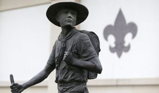 **FILE** Boy Scouts are honored with a statue in front of the National Scouting Museum in Irving, Texas. (Associated Press)