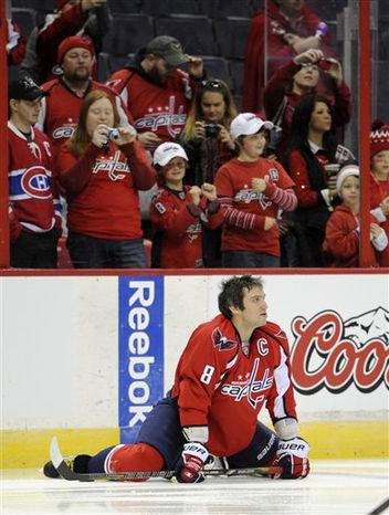 Washington Capitals left wing Alex Ovechkin (8), of Russia, looks on during warmups before an NHL hockey game against the Montreal Canadiens, Thursday, Jan. 24, 2013, in Washington. (AP Photo/Nick Wass)
