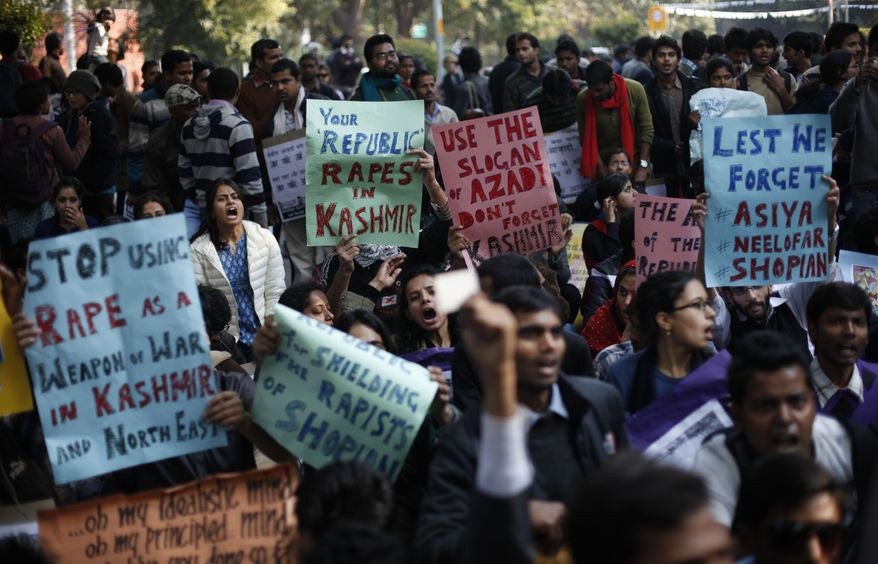 **FILE** Indians participate in a protest against gender discrimination and sexual violence in New Delhi on Jan. 26, 2013. The attack and brutal rape of a 23-year-old student in the heart of New Delhi in December has brought protesters into the streets demanding the government protect women and ensure those attacked get justice. (Associated Press)