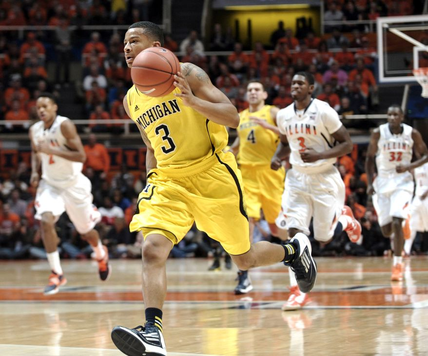 Michigan's Trey Burke (3) leads a fast break against Illinois during the second half of an NCAA college basketball game, Sunday, Jan. 27, 2013, in Champaign, Ill. Michigan won 74-60. (AP Photo/John Dixon)