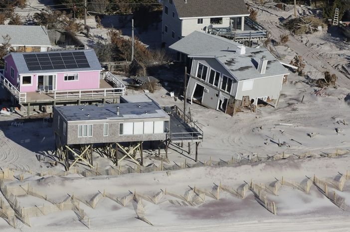 **FILE** This aerial photo from Jan. 18, 2013, shows homes damaged by Superstorm Sandy in Fire Island, N.Y. (Associated Press)