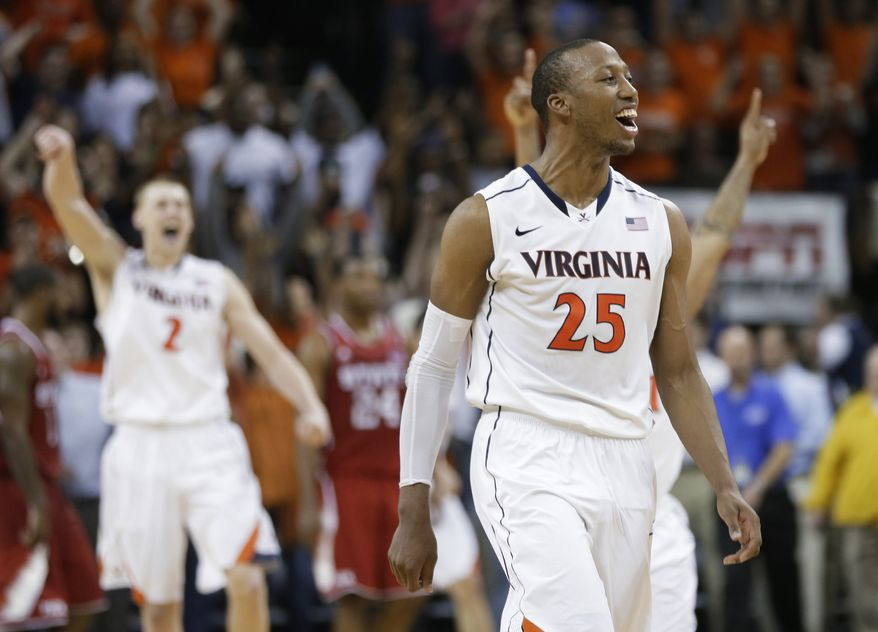 Virginia forward Akil Mitchell (25) celebrates his team's 58-55 win over North Carolina State in an NCAA college basketball game Tuesday, Jan. 29, 2013, in Charlottesville, Va. (AP Photo/Steve Helber)