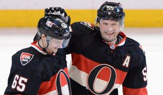 Ottawa Senators' Sergei Gonchar, right, celebrates his game-winning goal with teammate Erik Karlsson against the Washington Capitals during the third period of an NHL hockey game at the Scotia Bank Place in Ottawa, Ontario, on Tuesday, Jan. 29, 2013. (AP Photo/The Canadian Press, Sean Kilpatrick)