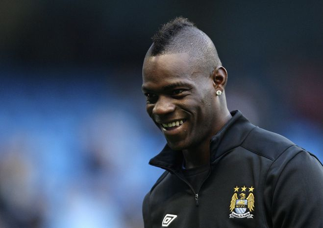 FILE - this Jan. 5, 2013 file photo shows Manchester City's Mario Balotelli smiling ahead of the English FA Cup 3rd round soccer match against Watford at The City of Manchester Stadium, Manchester, England. AC Milan says Tuesday, Jan. 29, 2013 that it has reached an agreement with Manchester City to sign Mario Balotelli and the Italy striker will undergo a medical on Wednesday. Balotelli is then expected to sign a four-and-a-half year deal with Milan, until 2017. (AP Photo/Jon Super, files)