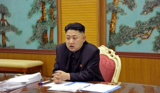 In this undated photo released by the Korean Central News Agency and distributed Sunday, Jan. 27, 2013, in Tokyo by the Korea News Service, North Korean leader Kim Jong Un attends a consultative meeting with officials in the fields of state security and foreign affairs at undisclosed location in North Korea. (AP Photo/Korean Central News Agency via Korea News Service)