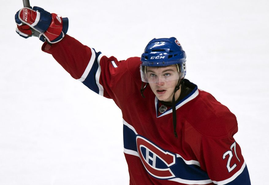 Montreal Canadiens' Alex Galchenyuk salutes the crowd after defeating the Florida Panthers 4-1 in their NHL hockey game, Tuesday, Jan. 22, 2013, in Montreal. (AP Photo/The Canadian Press, Paul Chiasson)