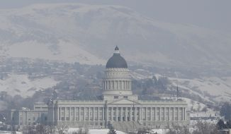 Smog from an inversion hangs over the Utah State Capitol on Jan. 23, 2013, in Salt Lake City. The U.S. Environmental Protection Agency has singled out the greater Salt Lake region as having the nation's worst air for much of January, when an icy fog smothers mountain valleys for days or weeks at a time and traps lung-busting soot. (Associated Press)