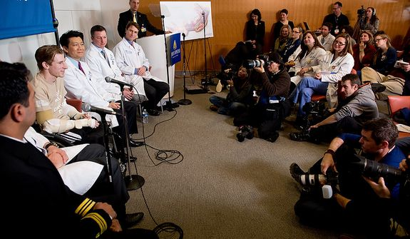 Iraq war veteran Brendan Marrocco, second from left, speaks at a press conference next to members of his surgical team lead by Johns Hopkins physicians who successfully performed the hospitalís first bilateral arm transplant, Baltimore, Md., Tuesday, January 29, 2013. Marrocco, who lost all four limbs from a bomb outside Baghdad, Iraq., is expected to slowly develop control over his new arms over the next year and a half. (Andrew Harnik/The Washington Times)
