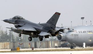 ** FILE ** A U.S. Air Force F-16 jet fighter from the 31st Fighter Wing lands at NATO's Aviano Air Base in Aviano, Italy, on Friday, March 25, 2011. (AP Photo/Luca Bruno)