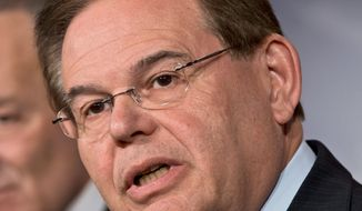 Sen. Robert Menendez, New Jersey Democrat, said he traveled on a plane owned by Dr. Melgen but denied that he engaged with prostitutes. (Associated Press)