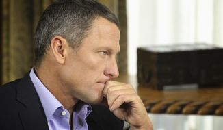 "Lance Armstrong listens as he is interviewed by talk show host Oprah Winfrey during taping for the show ""Oprah and Lance Armstrong: The Worldwide Exclusive"" in Austin, Texas, in this Jan. 14, 2013, file photo. Armstrong confessed to using performance-enhancing drugs to win the Tour de France cycling during the interview that aired Jan. 17, 2013, reversing more than a decade of denial. (Associated Press/Harpo Studios, Inc.) ** FILE **"