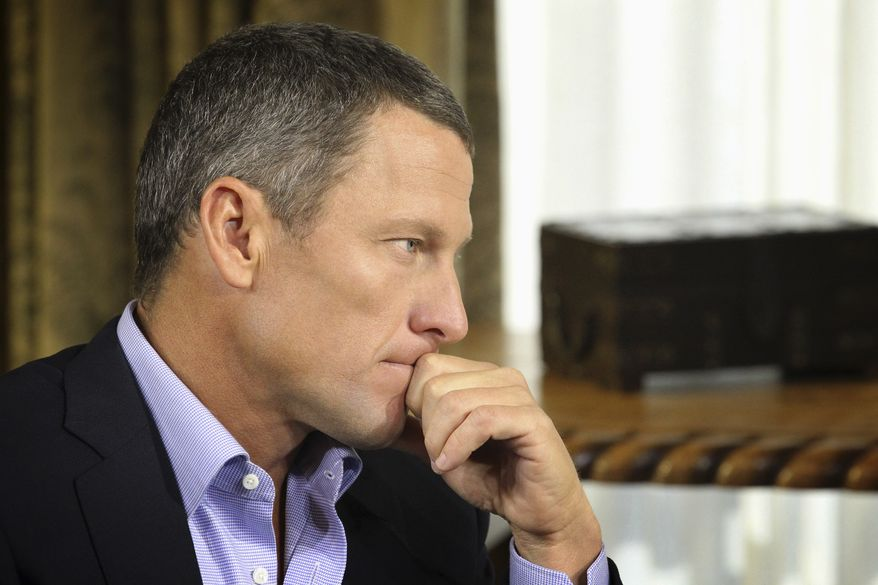 """Lance Armstrong listens as he is interviewed by talk show host Oprah Winfrey during taping for the show """"Oprah and Lance Armstrong: The Worldwide Exclusive"""" in Austin, Texas, in this Jan. 14, 2013, file photo. Armstrong confessed to using performance-enhancing drugs to win the Tour de France cycling during the interview that aired Jan. 17, 2013, reversing more than a decade of denial. (Associated Press/Harpo Studios, Inc.) ** FILE **"""